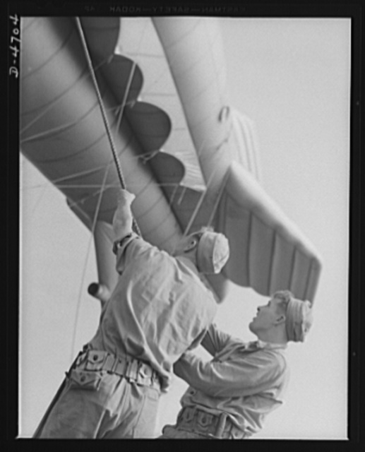 Parris Island. Marine Corps barrage balloons. A couple of husky marines and the ground tackle of a barrage balloon don't take long getting acquainted. Special Marine Corps units in training at Parris Island, South Carolina add balloon barrage technique to their large repertoire of fighting methods