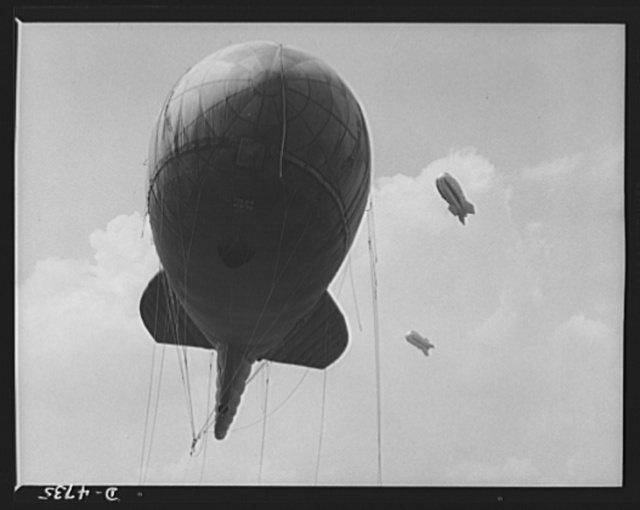 Parris Island. Marine Corps barrage balloons. Another stopper for the Axis. Sections of a marine balloon barrage over Paris Island, South Carolina. The swaying balloons with their trailing cables and steel winch lines make dive bombing and ground strafing of important locations too costly in planes and crews