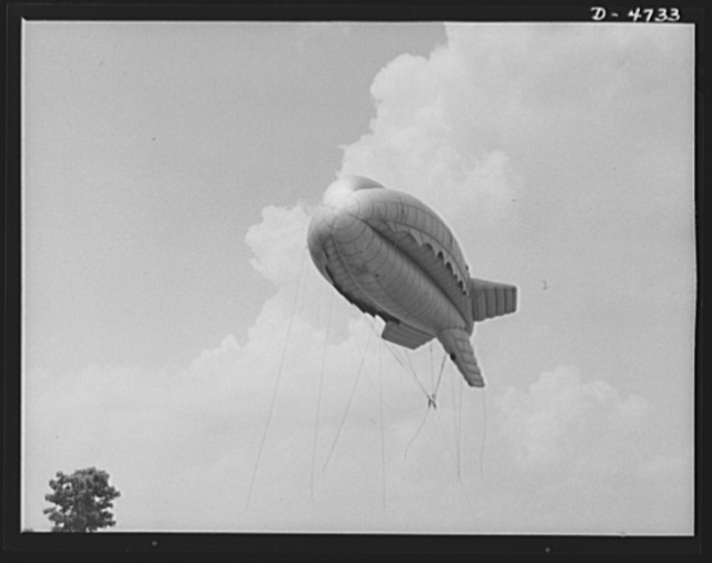 Parris Island. Marine Corps barrage balloons. Putting the Indian sign on Axis dive bombers and strafing planes. This barrage balloon, under control of a Marine unit in training at Parris Island, South Carolina is part of a plane trap that protects important ground installations. Planes cannot come close to a number of these balloons swaying in tactical formation, with steel cables trailing, without the danger of shearing off wings