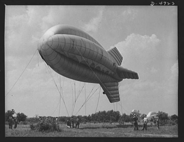 Parris Island. Marine Corps barrage balloons. Up she goes. A barrage balloon takes to the air under the capable handling of a Marine Corps ground crew at Parris Island, South Carolina. Special marine units assigned to the work have made the balloon barrage an effective method of preventing enemy air attacks on important locations