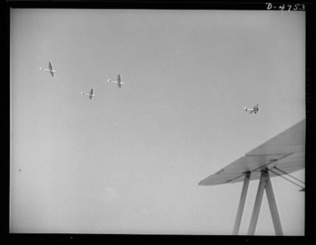 Parris Island. Marine Corps gliders. Leave it to the Marines to make the best of all the new fighting tools. Gyrene glider pilots in training at Page Field, Parris Island, South Carolina take a six-week course during which each student must complete 1000 successful takeoffs and landings. The plane is towing the three gliders