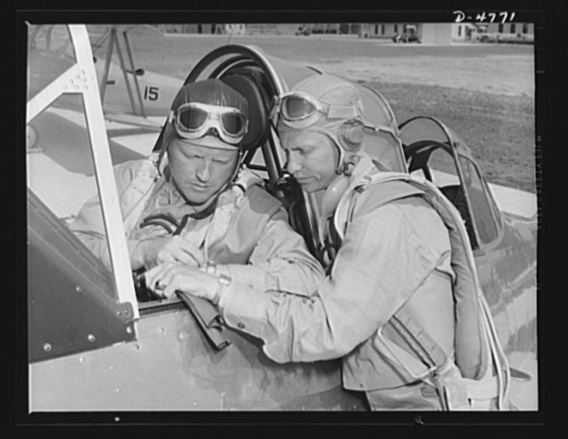 Parris Island. Marine Corps gliders. They fly without engines. Lieutenants of the Marine Corps, studying glider pilotage, compare notes before a flight