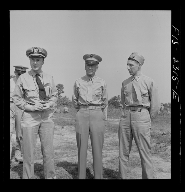 Parris Island, South Carolina. Brigadier General Emile Moses talking with a Marine Corps lieutenant and a Navy lieutenant at the U.S. Marines Corps glider detachment training camp