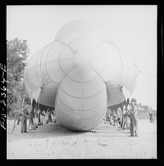 Parris Island, South Carolina. Special United States Marine units in training bedding down a big barrage balloon