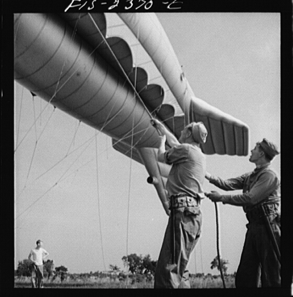 Parris Island, South Carolina. U.S. Marine Corps glider detachment training camp. A barrage balloon takes to the air under capable handling by a Marine Corps ground crew