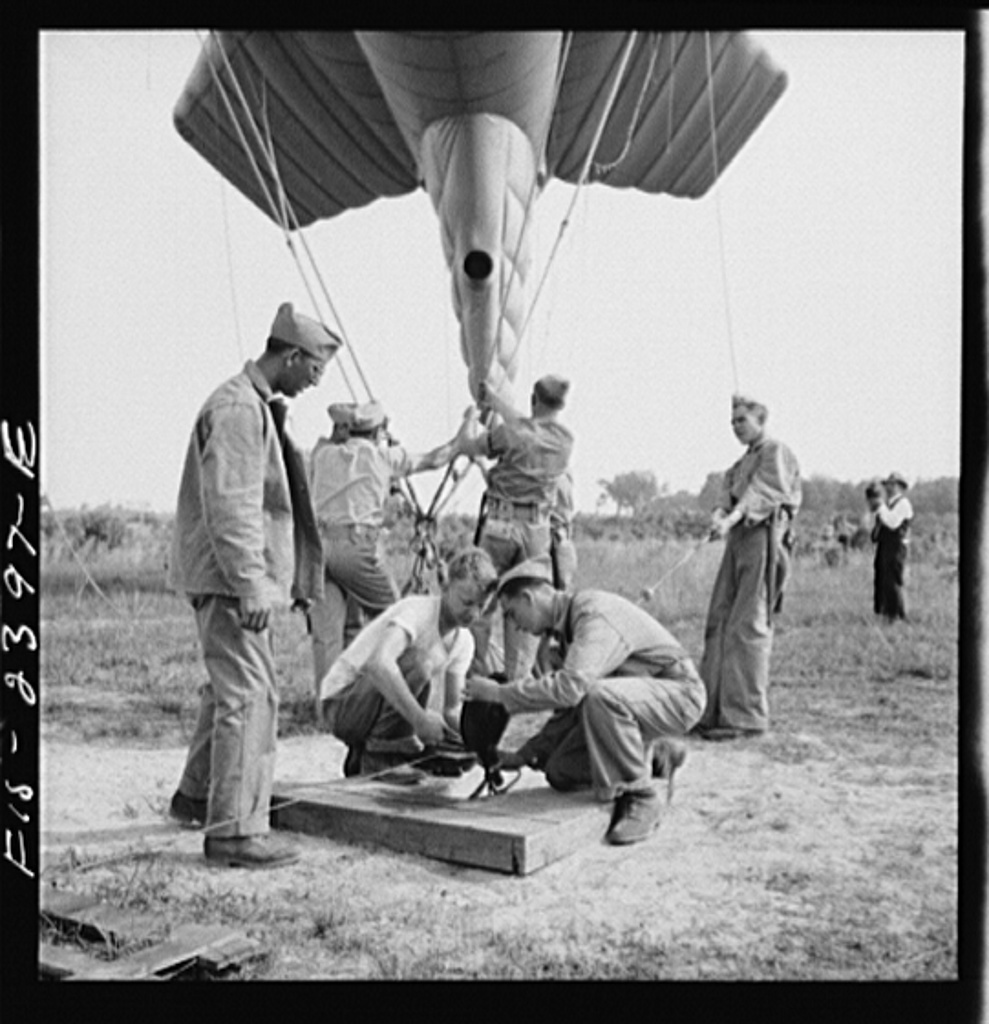 Parris Island, South Carolina. U.S. Marine Corps glider detachment training camp. Running up the barrage balloon into a tactical formation under control of a steelcable, a feature of technique at which the Marines at Parris Island must become proficient