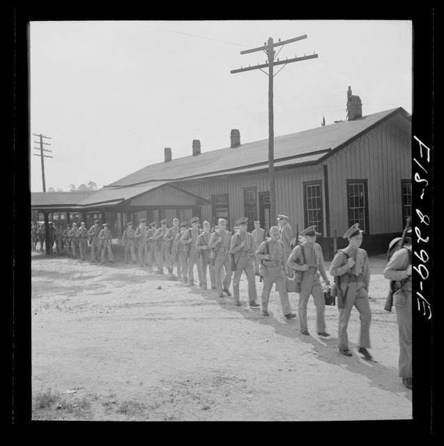 Parris Island, South Carolina. U.S. Marine Corps glider detachment training camp. Recruits on their way to the camp
