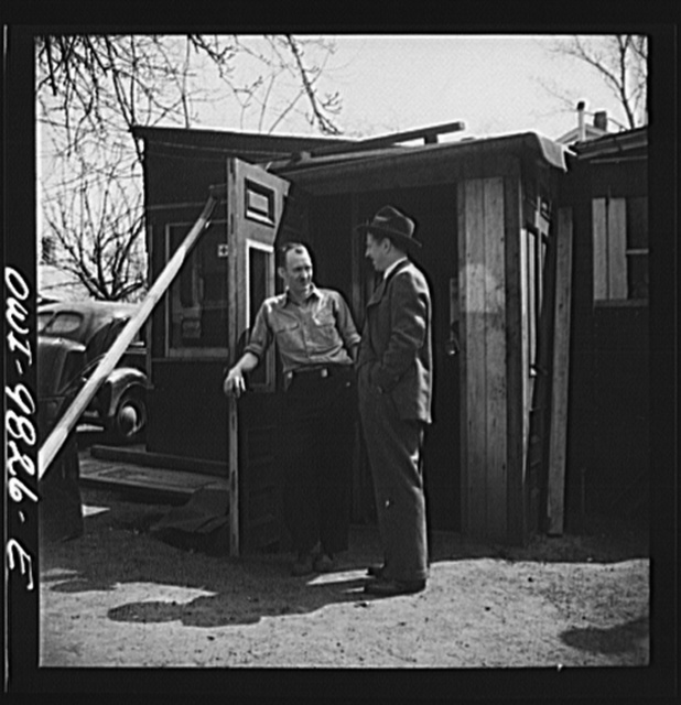 Passaic, New Jersey. Factory owner Carlson organized home machine shops for defense work. Carlson visiting one of the home workshop owners in the bach yard. Both men are of Sweedish origin