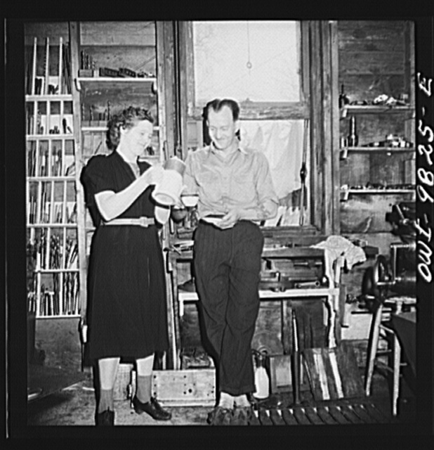 Passaic, New Jersey. Factory owner Carlson organized home machine shops for defense work. Home workshop owner's wife bringing coffee during the morning's work