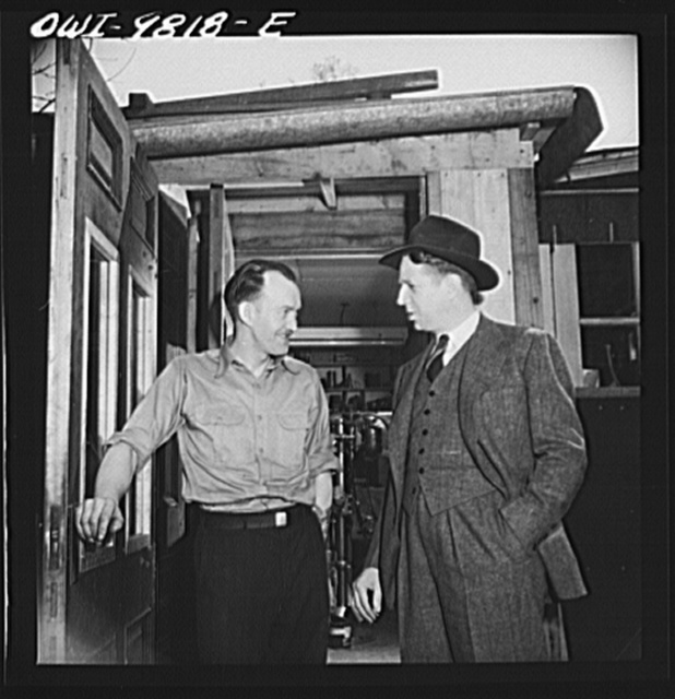 Passaic, New Jersey. Factory owner Carlson organized home machine shops for defense work. Carlson visiting one of the home workshop owners. Both men are of Sweedish origin