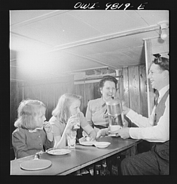 Passaic, New Jersey. Factory owner Carlson organized home machine shops for defense work. The Carlson family in the milkbar in the cellar playroom of their home in a Passaic suburb