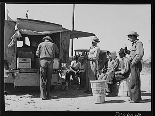 Pea pickers stop for a soft drink. Imperial County, California