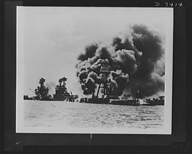Pearl Harbor bombing. Stricken from the air. Testifying to the extent of the Japanese sneak attacks are these three stricken U.S. battleships. Left to right: USS West Virginia, severely damaged; USS Tennessee, damaged; and USS Arizona, sunk