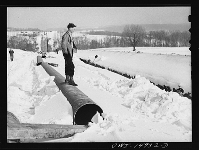 Pennsylvania section of the war emergency twenty-four inch pipeline to carry oil from Texas fields to eastern refineries, completed in July 1943. Straw boss over diggers removing rocks from ditch