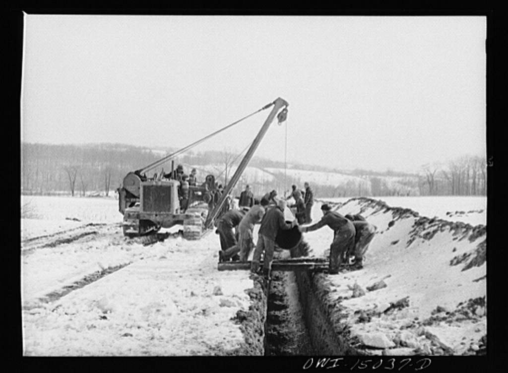 Pennsylvania section of the war emergency twenty-four inch pipeline to carry oil from Texas fields to eastern refineries, completed in July, 1943. Joining a section of pipe to the main line