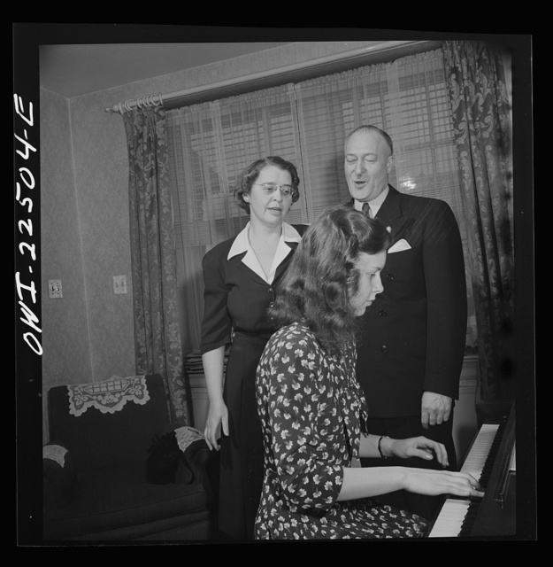 Philadelphia, Pennsylvania. Swedish-American executive at the SKF roller bearing factory sings Swedish songs with his wife and daughter