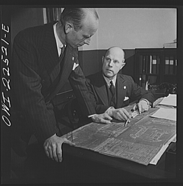 Philadelphia, Pennsylvania. Swedish-American vice-president and engineer of the SKF roller bearing factory looking over a blueprint