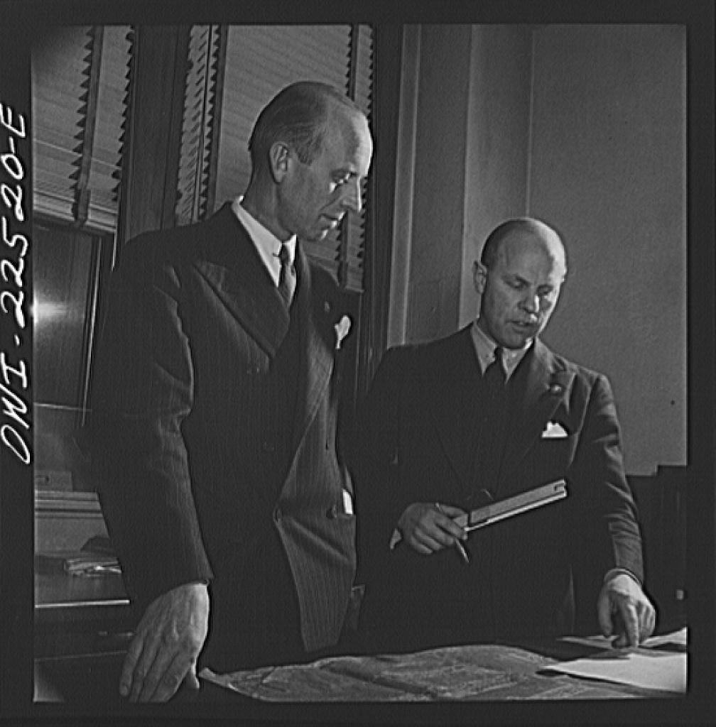 Philadelphia, Pennsylvania. Swedish-American vice president of the SKF roller bearing factory and engineer looking over a blueprint