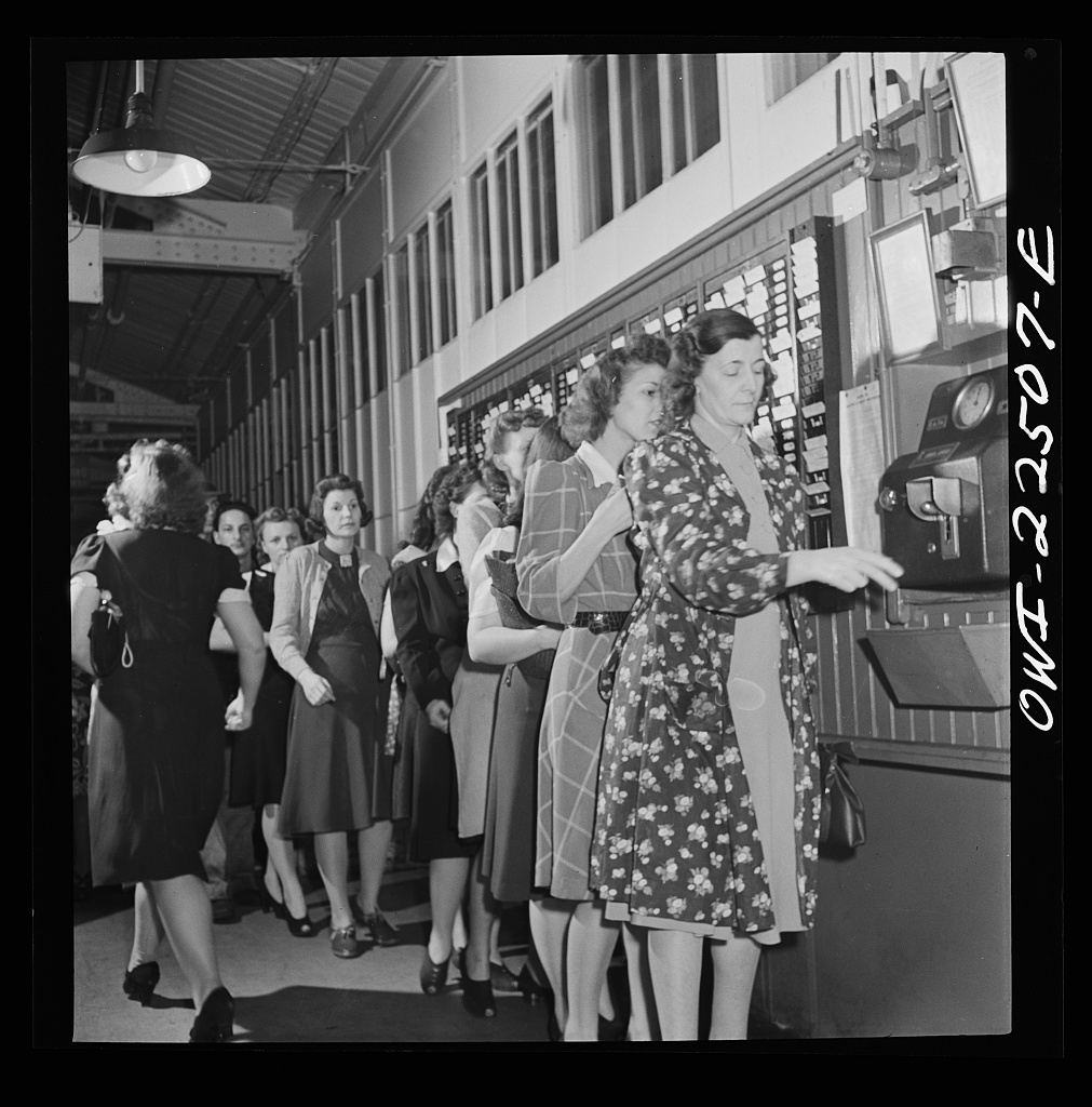 Philadelphia, Pennsylvania. Workers punching the clock at the SKF roller bearing factory