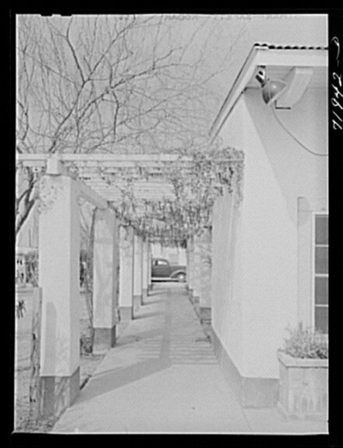 Phoenix, Arizona. Camelback Farms, FSA (Farm Security Administration) project. Open passageway of the community building