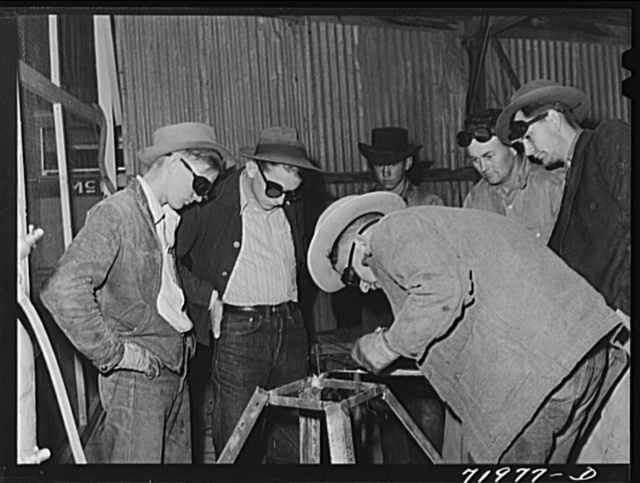 Pinal County, Arizona. Defense training project, U.S. Department of Education welding school. All these men and boys live on the farms and ranches nearby. Some men, who are agricultural workers living at the FSA (Farm Security Administration) farm workers' community at Eleven Mile Corner, attend this class