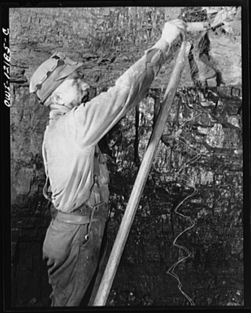 "Pittsburgh, Pennsylvania (vicinity). Montour no. 4 mine of the Pittsburgh Coal Company. Miner putting powder charge into a face of coal which is to be ""shot down"""