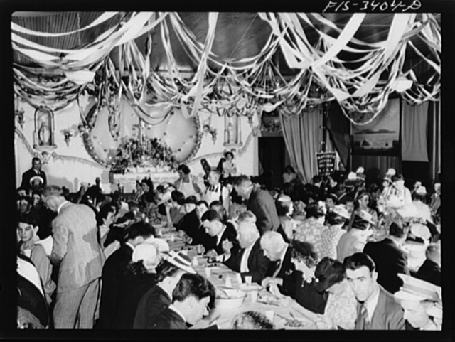 Portuguese-Americans eating dinner in the I.D.E.S.I. hall at the Festival of the Holy Ghost at Novato, California