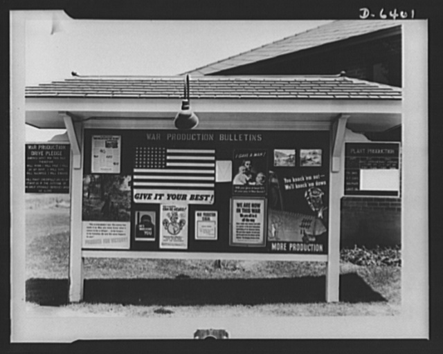 Posters displayed on this large, well-lighted bulletin board drive home the urgency of more and better production to employees of the Columbia Steel Company, Provo, Utah. Some of the posters were supplied by war production drive headquarters, some by the local labor-management committee