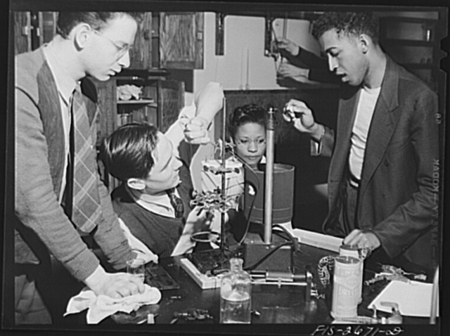 Postgraduate students studying physiology of the muscle. The experiment is with frogs' muscle tissue. Left to right: 1) J.S. Newcomer, graduate of University of Utah and majoring in organic chemistry. 2) A.E. Bell, graduate of University of Kentucky, genetics major. 3) Hiss Trondailer Jones, graduate of Lincoln University at Jefferson City, Missouri, taking postgraduate work in nutrition. 4) Samuel Massie, of Little Rock, Arkansas, studied at Arkansas State, taking postgraduate work in organic chemistry