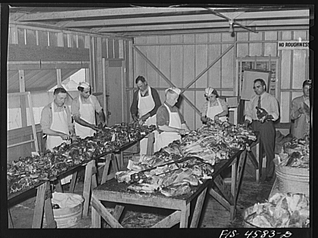 Preparing beef for barbecue dinner at the fiesta of the Holy Ghost. Santa Clara, California