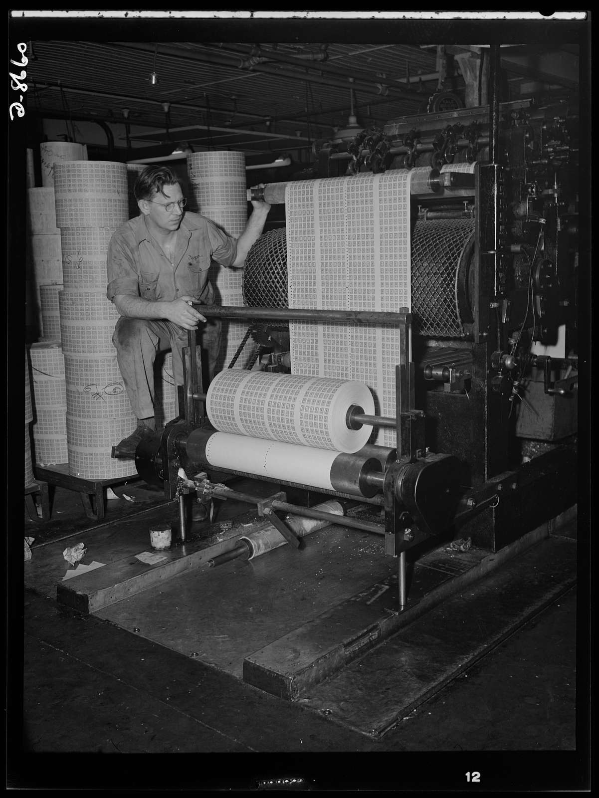 Printing war ration book 2. Printing coupons for war ration book 2. Pressman Adolph Beyer watches as the coupons roll from the press in a steady stream at a printing establishment in Hoboken, New Jersey