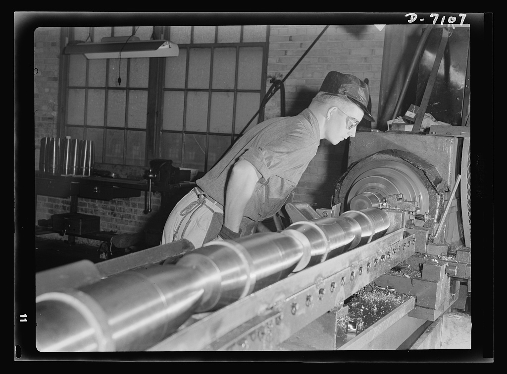 Production. 105 millimeter shells. Plumbing fixtures came off these assembly lines in peace time, but today Giles Knowles and his fellow workers produce 105 millimeter shells in a Midwest plant now converted 100 percent to war production. Knowles, a minor league baseball pitcher, broke a league record for strike-out; now he's out to break the company record for shell production (Manitowac Shipyards)