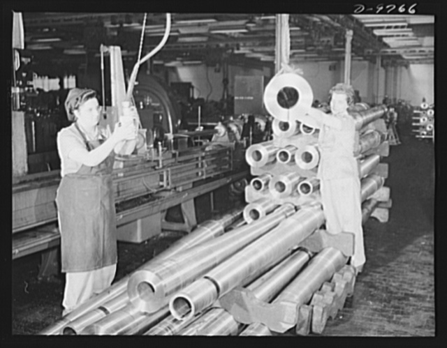 Production. 105 mm. howitzers. Lillian Goritschnig and her helper, Frances Heipek, removing turned 105 mm. howitzers from stockpile for honing operation at the Milwaukee, Wisconsin plant of Chain Belt Company