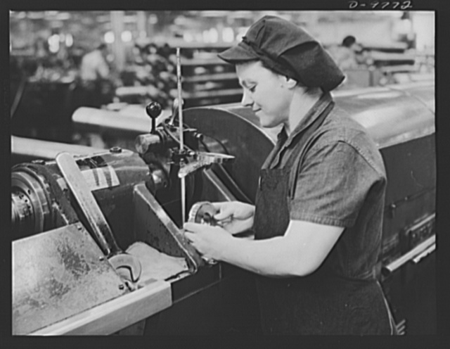 Production. 105 mm. howitzers. Mrs. Mary Betchner inspecting one of the twenty-five cutters for burrs before inserting it in the inside of a 105 mm. howitzer in the Milwaukee, Wisconsin plant of Chain Belt Company. Her son is in the Army; her husband and daughter are in war work