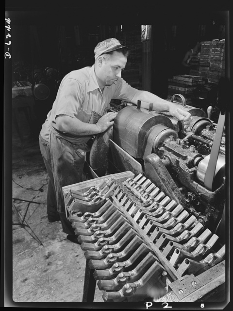 Production. 45-caliberautomatic pistols. Anthony Freda drills the barrels of .45-caliber automatic pistols in the plant of a large manufacturer of firearms. Many men and women are employed in this plant which produces pistols, machine guns, and other essential weapons for the armed forces