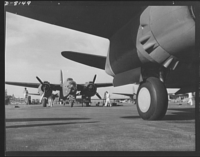 Production. A-20 attack bombers. Mechanics on the flight ramp on the Douglas Aircraft Company at Long Beach, California, check final adjustments on an A-20 attack bomber just before delivery to the Army. The A-20 is used by the American Air Force and Royal Air Force (RAF) for hedge hopping and strafing operations against ground troops and installations--also for reconnaissance work and night fighting. It is armed with light and heavy caliber guns
