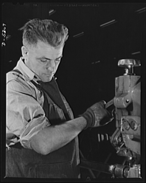 Production. Aircraft. A precision machinist in the machine shop of a large Western aircraft factory. Since variation from perfection may mean a jammed gun, a faulty landing-gear or a stalled engine, men like this are now at an all time premium