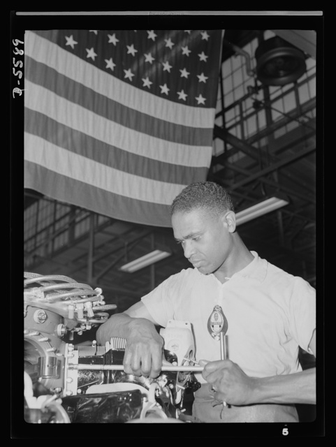Production. Aircraft engines. A skilled mechanic and determined war worker, Zed W. Robinson, proves that skin pigment bears no relation to efficiency of work. He's one of many Negroes employed in a large Midwest aircraft plant in skilled and semi-skilled capacity. Tightening bolts of a cylinder barrel during the final build-up of an airplane engine is one of the jobs which, until fairly recently, was closed to members of his race. But this war demands that no American because of race, creed or color shall be barred from work. Melrose Park, Buick plant