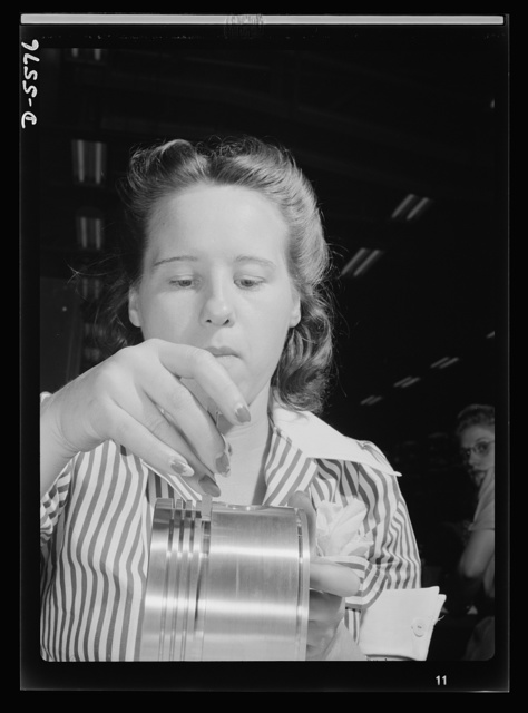Production. Aircraft engines. A veteran of the assembly bench, twenty-two-year-old Anne Weinmen, employee of a large Midwest aircraft factory, inspects pistons to be used in airplane engines. With several years experience in Midwestern plants behind her, Miss Weinmen has developed the patience and dexterity this work requires. Melrose Park, Buick plant
