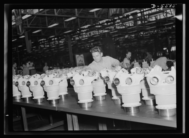 Production. Aircraft engines. Ready for inspection, this line-up of cylinder barrels for airplane engines makes a formidable display. Engines for America's Victory bombers are manufactured in this enormous Midwest plant. Melrose Park, Buick plant