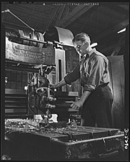 Production. Aircraft. This worker on America's battle line of production shows all the grim intent of purpose one would expect to find in the trenches on Bataan and in the gun emplacements of Corregidor. He operates a Gray milling machine in a large Western aircraft plant