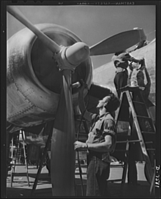 """Production. Airplane manufacture, general. A painter sprays the propeller of a B-25 bomber at the big North American plant in Inglewood, California. This plant produces the battle-tested B-25 (""""Billy Mitchell"""") bomber, used in General Doolittle's raid on Tokyo, and the P-51 (""""Mustang"""") fighter plane, which was first brought into prominence by the British raid on Dieppe"""