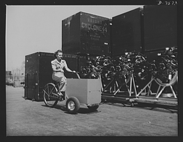 "Production. Airplane manufacture, general. A production control clerk at  North American Aviation's Inglewood, California, plant carries rush parts to various departments with a special luggage-carrying tricycle. This plant produces the battle-tested B-25 (""Billy Mitchell"") bomber, used in General Doolittle's raid on Tokyo, and the P-51 (""Mustang"") fighter plane, which was first brought into prominence by the British raid on Dieppe"
