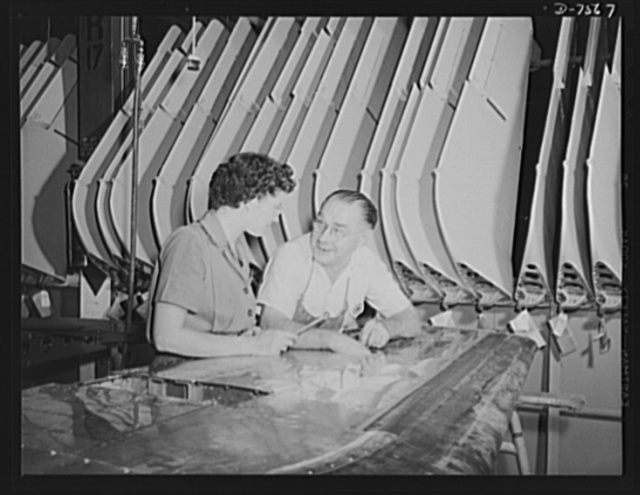 "Production. Airplane manufacture, general. An employee with years of experience at Inglewood, California, plant of North American Aviation, Incorporated, explains the assembly of a horizontal stabilizer to a new woman employee. This plant produces the battle-tested B-25 (""Billy Mitchell"") bomber, used in General Doolittle's raid on Tokyo, and the P-51 (""Mustang"") fighter plane, which was first brought into prominence by the British raid on Dieppe"