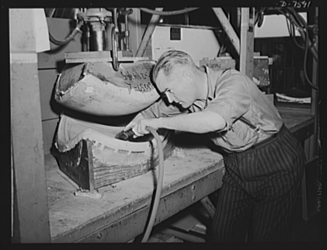"Production. Airplane manufacture, general.  Forming lucite (a shatter-proof plastic ""glass"") for war plane enclosures requires extreme care. Here an employee at North American Aviation's Inglewood, California plant cleans a mold with compressed air before forming the part. This plant produces the battle-tested B-25 (""Billy Mitchell"") bomber, used in General Doolittle's raid on Tokyo, and the P-51 (""Mustang"") fighter plane, which was first brought into prominence by the British raid on Dieppe"