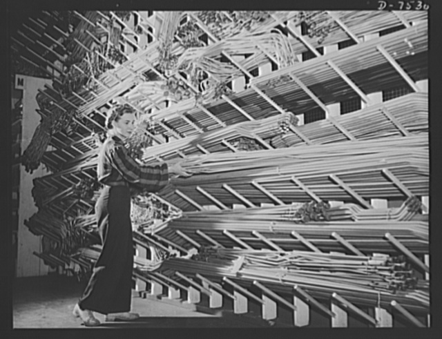 "Production. Airplane manufacture, general. Miles of preformed aluminum alloy tubing are placed on racks in stockrooms ready for assembly in bomber and fighter planes built at the Inglewood, California, plant of North American Aviation, Incorporated, where women are fast taking over the jobs of the stockmen. This plant produces the battle-tested B-25 (""Billy Mitchell"") bomber, used in General Doolittle's raid on Tokyo and the P-51 (""Mustang"") fighter plane, which was first brought into prominence by the British raid on Dieppe"