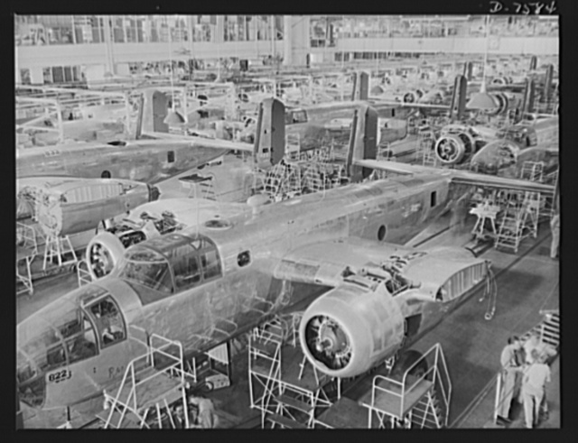 "Production. Airplane manufacture, general. Partial view of North American Aviation's B-25 final assembly floor at Inglewood, California. This plant produces the battle-tested B-25 (""Billy Mitchell"") bomber, used in General Doolittle's raid on Tokyo, and the P-51 (""Mustang"") fighter plane, which was first brought into prominence by the British raid on Dieppe"