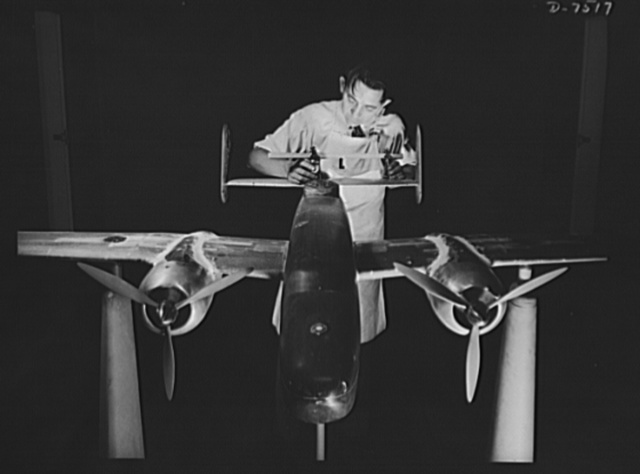 "Production. Airplane manufacture, general.  Preparing an experimental scale model of the B-25 bomber for the wind tunnel tests in the Inglewood, California, plant of North American Aviation, Incorporated. The model maker is adjusting the empennage to its correct position. This plant produces the battle-tested B-25 (""Billy Mitchell"") bomber, used in General Doolittle's raid on Tokyo and the P-51 (""Mustang"") fighter plane, which was first brought into prominence by the British raid on Dieppe"