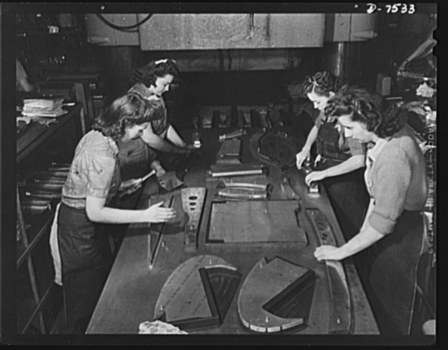 "Production. Airplane manufacture, general. Sheet metal plane parts, previously cut on a router are pressed to all the required shapes on Masonite dies in a 3,000 ton hydraulic press in the Inglewood, California, plant of North American Aviation, Incorporated. Four crews of girls, one at each side, feed and operate the press. The actual forming operation takes only about ten seconds. This plant produces the battle-tested B-25 (""Billy Mitchell"") bomber, used in General Doolittle's raid on Tokyo, and the P-51 (""Mustang"") fighter plane, which was first brought into prominence by the British raid on Dieppe"
