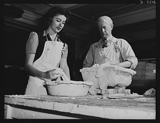 "Production. Airplane manufacture, general.  The sculptor's art plays an important part in making dies for the production of modern airplanes. An old master at the Inglewood, California, plant of North American Aviation, Incorporated works with plaster mixed to the proper consistency by a young woman assistant. From his plaster models will be made the metal dies with which plane parts are formed in hydraulic presses. This plant produces the battle-tested B-25 (""Billy Mitchell"") bomber, used in General Doolittle's raid on Tokyo and the P-51 (""Mustang"") fighter plane, which was first brought into prominence by the British raid on Dieppe"